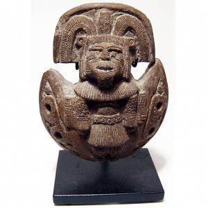 ancient ocarina with headdress