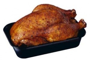 cooked chicken in an oven pan