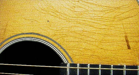 cracks in guitar from humidity problems