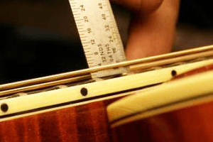guitar intonation string action