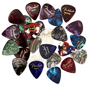 assorted guitar picks thickness