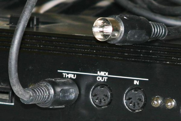 MIDI connectors and MIDI cable, showing the in, out, and thru ports plus five-pin DNI connector