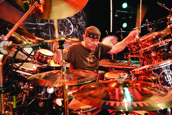 Neil Peart of Rush is one of the best drummers of all time known for his huge drum set and showmanship