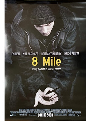 8 Mile is not only one of the best movies about music, but it's a solid movie period. It's about rapping, freestyle battles, and is kind of about Eminem's life.