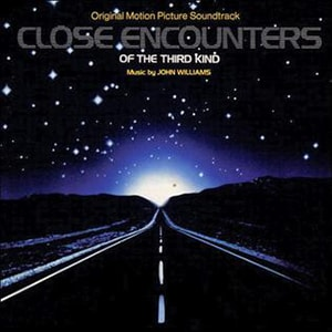 Close Encounters of the Third Kind has a top movie score also by John Williams, the king of scores. It has an incredibly recognizable theme.