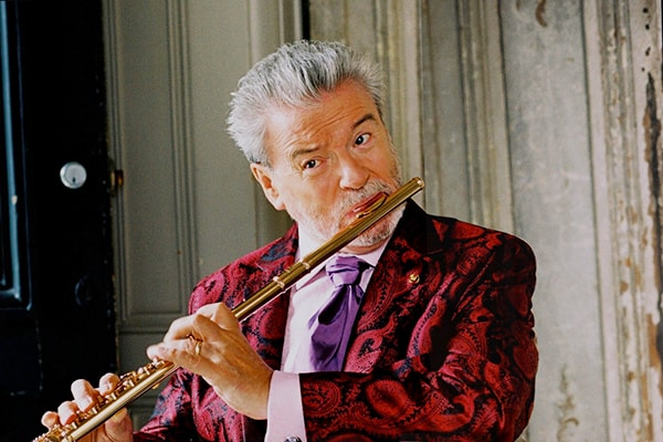 Sir James Galway is our top pick for the best flute players in the world. He's an Irish flutist known for bridging music genres effortlessly.